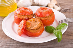 Stuffed tomatoes on a white plate. Stock Photo