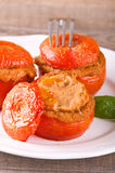 Stuffed tomatoes on a white plate. Stock Photos