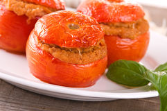 Stuffed tomatoes on a white plate. Royalty Free Stock Image