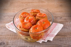 Stuffed tomatoes on a white plate. Royalty Free Stock Photography