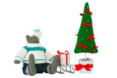 Stuffed tomcat toy, fir tree and gift box. Stuffed tomcat toy in pants sits with fir tree toy and gift box on a sled nearby. Decoration for Christmas. Isolated Stock Image