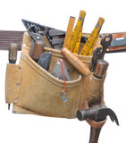 Stuffed Tool belt. Tool Belt Stuffed with assorted hand tools isolated over white royalty free stock photos