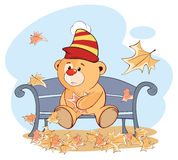 A stuffed toy bear cub and falling leaves. Cartoon Royalty Free Stock Photo
