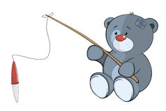 The stuffed toy bear cub the fisherman. Cartoon Stock Photos