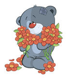 The stuffed toy bear cub and flowers Stock Photos
