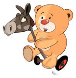 A stuffed toy bear cub and a wooden horse cartoon Royalty Free Stock Photo