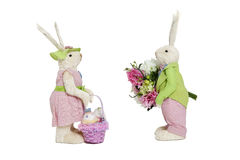 Stuffed toys portrayed as male with flowers and female with basket over white background Royalty Free Stock Photo