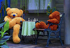 Stuffed toys two teddy bears playing chess Stock Photography