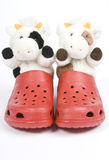 Stuffed Toys Wearing Red Plastic Clogs Royalty Free Stock Photos