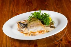 Stuffed trout. With mushrooms and sauce royalty free stock photo