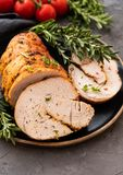 Stuffed turkey breast with baked vegetables and spices on a black background. Stuffed turkey breast with baked vegetables and spices against holiday background stock photography