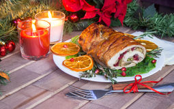 Stuffed turkey breast with baked vegetables and spices against holiday lights background. Stuffed turkey breast with baked vegetables and spices against holiday royalty free stock photo