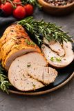 Stuffed turkey breast with baked vegetables and spices on a black background. Stuffed turkey breast with baked vegetables and spices against holiday background royalty free stock photography