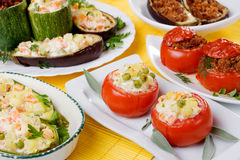 Stuffed vegetable. Tomato, aubergine and zucchini stuffed with vegetable and sour cream filling Royalty Free Stock Photo