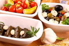 Stuffed vine leaves and Mediterranean antipasti Royalty Free Stock Images