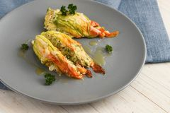 Stuffed zucchini or courgette blossoms baked with parmesan chees Stock Photography