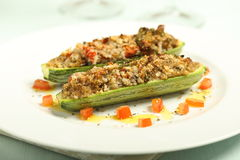 Stuffed zucchini gratin on white plate Royalty Free Stock Images