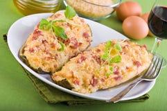 Stuffed zucchini halves. Royalty Free Stock Photography