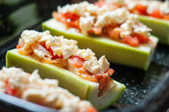 Stuffed zucchini. Zucchini with sliced tomatoes fresh bean pods and cheese in a tray stock image