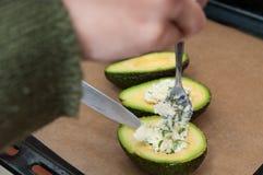 Stuffing avocados Stock Photo