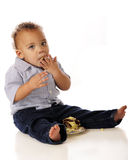 Stuffing Cake. An adorable mixed race toddler stuffing cake in his mouth.  Isolated on white Stock Photography