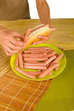 Stuffing a hot dog, fast food Royalty Free Stock Images