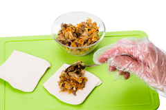 Stuffing with mushrooms Stock Photo