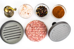 Stuffing and press for burger on white background Royalty Free Stock Images