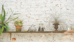 Stuffs decorated on wall. Stuffs decorated on brick wall Royalty Free Stock Photos