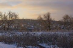 Stugby i vinter Fotografering för Bildbyråer