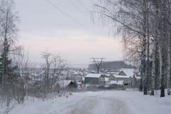 Stugby i vinter Royaltyfri Bild