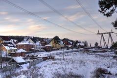 Stugby i vinter Royaltyfria Bilder