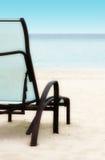 Stuhl auf dem Strand Stockbild
