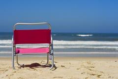 Stuhl auf dem Strand Stockfoto