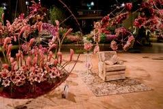 Stuhl-Blumen-Erscheinen Stockfotografie