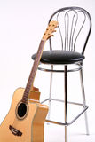 Stuhl und Gitarre Lizenzfreies Stockbild
