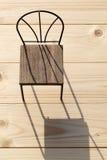 Stuhl und Schatten Lizenzfreie Stockbilder