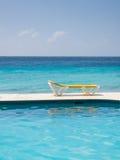 Stuhl und Wasser Stockbild