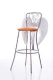Stuhl und weiße Engelsflügel Lizenzfreie Stockfotografie