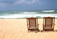 Stuhl zwei am Strand Stockbild