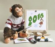 Stuk speelgoed aap - schilder Stock Afbeeldingen