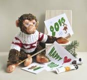 Stuk speelgoed aap - schilder Stock Afbeelding