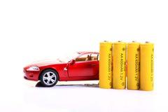 Stuk speelgoed auto en batterijen Stock Fotografie