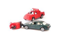 Stuk speelgoed auto en motorfiets in ongeval Royalty-vrije Stock Fotografie