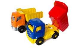 Stuk speelgoed auto's op een wit geïsoleerde achtergrond Vrachtwagens met een lichaam Vrachtwagenstuk speelgoed auto's royalty-vrije stock foto