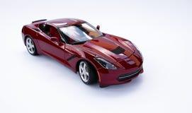 Stuk speelgoed automodel op een witte achtergrond stock afbeeldingen