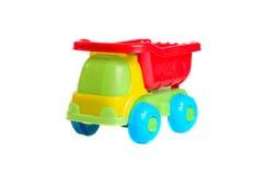 Stuk speelgoed autovrachtwagen op een geïsoleerde achtergrond Stock Foto