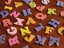 Stuk speelgoed brieven stock foto