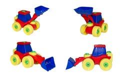 Stuk speelgoed, de bulldozer voor sneeuw en gemalen lading. Stock Foto's