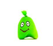Stuk speelgoed in de vorm van groene glimlach Royalty-vrije Stock Fotografie